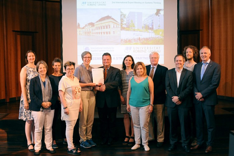 Staff from the International Institute of Applied Systems Analysis (IIASA) and the University of Koblenz-Landau (UKOLD) met for the announcement of the agreement. Photo: University of Koblenz-Landau